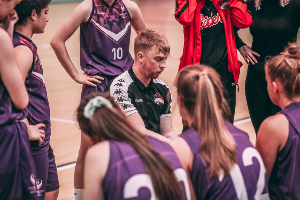 Coach Oli Parr in a timeout with the Loughborough Riders team.
